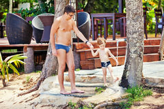 Father and son washing the feet Royalty Free Stock Image