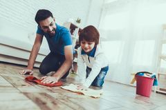 Father and Son Washing the Floor royalty free stock image