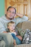 Father and son watch tv. At home Stock Photos