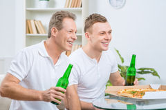 Father and son watching football match Stock Photo