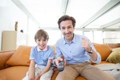 Father and son watching tv royalty free stock image