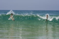 Father and son in the waves Royalty Free Stock Image