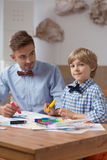Father and son wearing bow ties Stock Photo