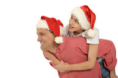 Father with son  wearing Christmas  caps Stock Photography