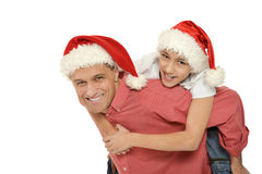 Father with son  wearing Christmas  caps Royalty Free Stock Photography