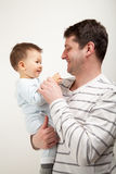 Father and son wearing pajamas. Smilling Royalty Free Stock Image