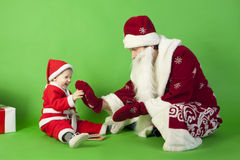 Father and son wearing Santa costume Royalty Free Stock Photography