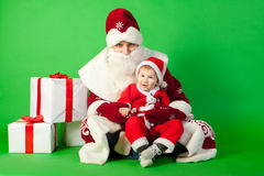 Father and son wearing Santa costume Royalty Free Stock Image