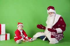 Father and son wearing Santa costume Royalty Free Stock Photo