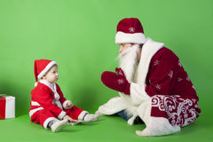 Father and son wearing Santa costume Royalty Free Stock Photos