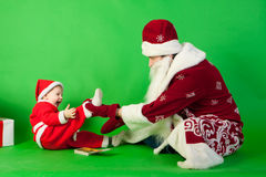 Father and son wearing Santa costume Stock Photography