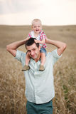 Father with son in the wheat field Royalty Free Stock Photo