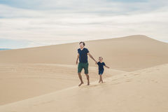 Father and son at the white desert. Traveling with children concept stock photos