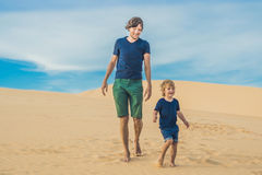 Father and son at the white desert. Traveling with children concept stock photo