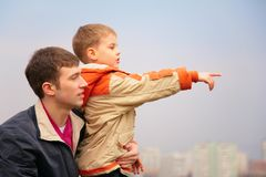Father with son who points finger to right Stock Photography