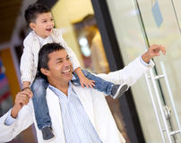Father and son window shopping Stock Images