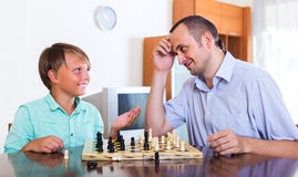 Father and son winning game Stock Image