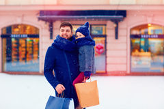 Father and son on winter shopping in city, holiday season, buying presents. Happy father and son on winter shopping in city, holiday season, buying presents Royalty Free Stock Photography