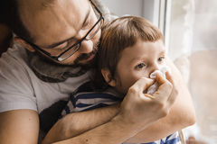 Father and son wiping nose, illness. Cold Royalty Free Stock Images