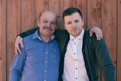Father and son on wooden background Royalty Free Stock Images