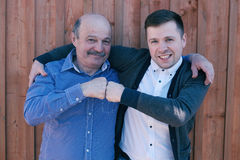 Father and son on wooden background Stock Images