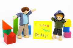 Father and son wooden toys with card Stock Images