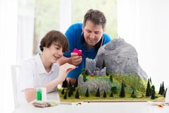 Father and son work on model building project Royalty Free Stock Images