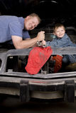 Father son working on car Stock Image