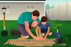 Father and son working on a flower garden Royalty Free Stock Photos