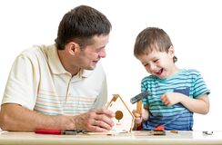 Father and son working with hammer together Stock Photos