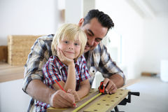 Father with son working on home improvement Stock Photography