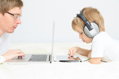Father and son working from home Royalty Free Stock Image