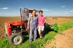 Father and son working together on agricultural fields in spring Stock Photo
