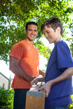 Father and son working together. Royalty Free Stock Photo