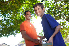 Father and son working together. Royalty Free Stock Photos