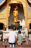 Father and son worshiping Buddha Royalty Free Stock Photos