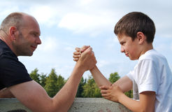 Father and son in wrist fight Royalty Free Stock Photo