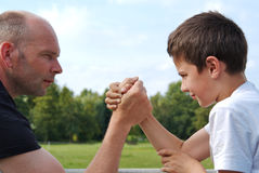 Father and son in wrist fight Stock Photo