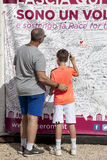 Father and son writing on a wall solidarity, breast female cancer. A father and son wrote on a wall for solidarity in the fight against cancer, female breast royalty free stock image