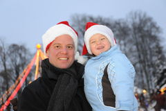 Father and Son with x-mas hats Stock Images