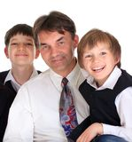 Father with sons. Studio portrait of a father and his two sons, isolated on a white background Stock Photography