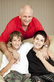 Father and Sons. Portrait of a loving father with his two sons Royalty Free Stock Photo