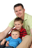 Father and sons. Portrait style image of a young father with his two sons Royalty Free Stock Photography