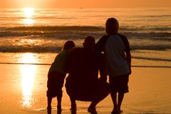 Father and sons. At sunrise Royalty Free Stock Photos