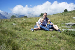 Father and Sons in an alpine meadow Stock Photography