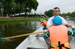 Father and sons on the boat. In the park Royalty Free Stock Image