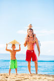 Father and Sons Going Surfing Stock Images