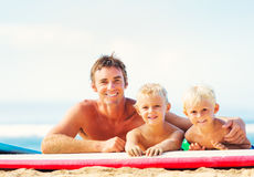 Father and Sons Going Surfing Stock Photography