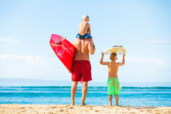 Father and Sons Going Surfing. Father and Young Sons Going Surfing at the Beach, Looking out at the Ocean Checking the Waves Stock Photos