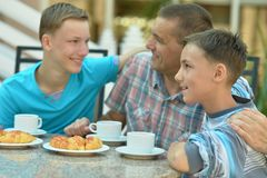 Father and sons having breakfast Royalty Free Stock Photo